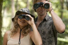 Couple with Binoculars Royalty Free Stock Photography