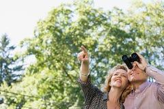 Couple with binoculars royalty free stock photo