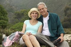 Couple with binoculars in countryside (portrait) Royalty Free Stock Photography