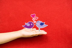 Couple birds lovely on a hand Royalty Free Stock Image