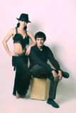 Couple in black dancers costume Stock Images