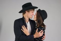 Couple in black hats Royalty Free Stock Image