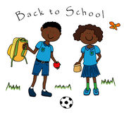 Couple of black kids going to school. Back to school: couple of black guys, a boy and a girl, dressed in their school uniform and going back to school Stock Images