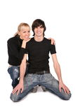Couple in black sits Royalty Free Stock Images