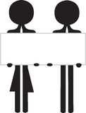 Couple with blanc information board Royalty Free Stock Photography