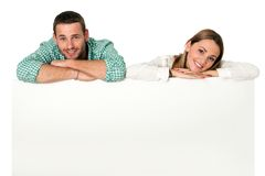 Couple with blank board for ads. Royalty Free Stock Photography