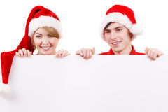 Couple with blank empty banner board. Christmas Stock Photography