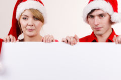 Couple with blank empty banner board. Christmas Stock Photo