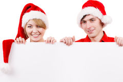 Couple with blank empty banner board. Christmas Stock Image