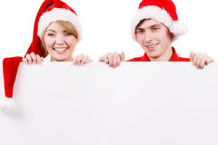 Couple with blank empty banner board. Christmas Stock Photos