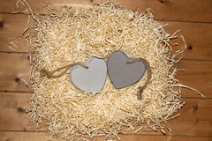 Couple of blank grey wooden love hearts Royalty Free Stock Photo