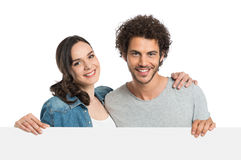 Couple With Blank Sign Royalty Free Stock Photo