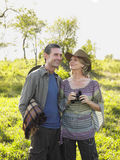 Couple With Blanket And Binoculars On Meadow Royalty Free Stock Images