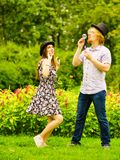 Couple blowing bubbles outdoor stock photo