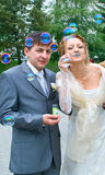 Couple blowing the soap bubbles Royalty Free Stock Photo
