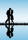 Couple on blue background Stock Images