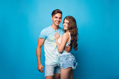 Couple on blue background Royalty Free Stock Photography