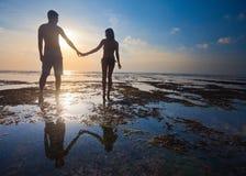 Couple at blue beach Stock Photo