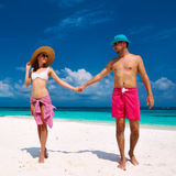 Couple in blue on a beach at Maldives Stock Image