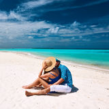 Couple in blue on a beach at Maldives Stock Photography