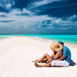 Couple in blue on a beach at Maldives Stock Photo