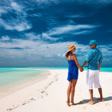 Couple in blue on a beach at Maldives Stock Photos