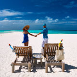 Couple in blue on a beach at Maldives Royalty Free Stock Photo