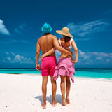 Couple in blue on a beach at Maldives Royalty Free Stock Image