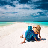 Couple in blue on a beach at Maldives Royalty Free Stock Photography