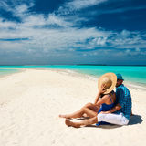 Couple in blue on a beach at Maldives Royalty Free Stock Photos