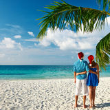 Couple in blue clothes on a beach at christmas Stock Images