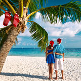 Couple in blue clothes on a beach at christmas Royalty Free Stock Image