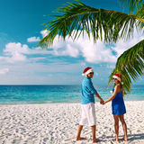 Couple in blue clothes on a beach at christmas Stock Image