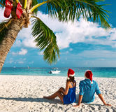 Couple in blue clothes on a beach at christmas Stock Photography