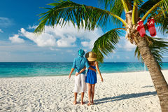 Couple in blue clothes on a beach at christmas. Couple in blue clothes on a tropical beach at christmas Stock Photography