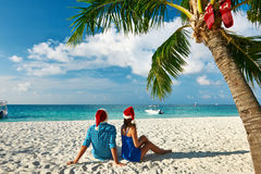 Couple in blue clothes on a beach at christmas Stock Photos