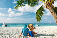 Couple in blue clothes on a beach at Maldives Stock Image