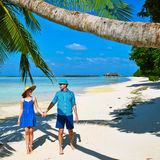 Couple in blue clothes on a beach at Maldives Royalty Free Stock Image