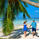 Couple in blue clothes on a beach at Maldives Royalty Free Stock Photography