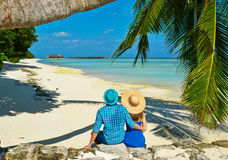 Couple in blue clothes on a beach at Maldives Stock Photos