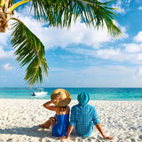 Couple in blue clothes on a beach at Maldives Stock Images