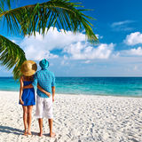 Couple in blue clothes on a beach at Maldives Royalty Free Stock Photos