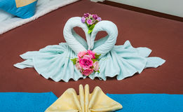 Couple of Blue Green Swans in Heart Shaped Towel Royalty Free Stock Image