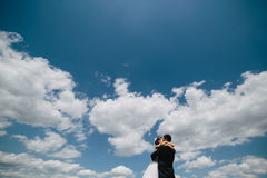 Couple on blue sky background Royalty Free Stock Photos