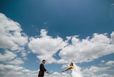Couple on blue sky background Royalty Free Stock Images