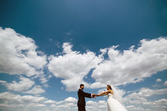 Couple on blue sky background Royalty Free Stock Image
