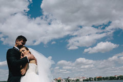 Couple on blue sky background, water Royalty Free Stock Image