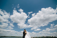 Couple on blue sky background, water Royalty Free Stock Photography