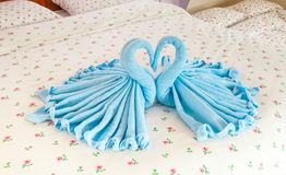 Couple of Blue Swans in Heart Shaped Towel Royalty Free Stock Image