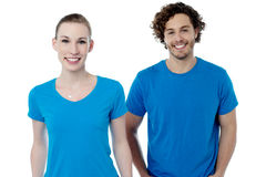 Couple in blue t-shirts. Isolated over white. Royalty Free Stock Image